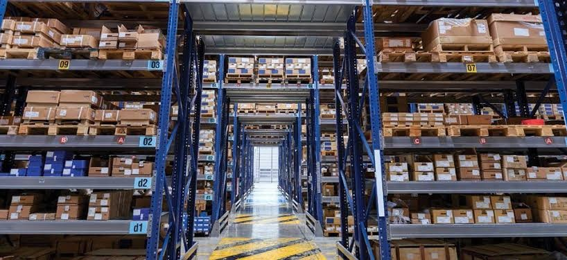 What are the key factors and principles of distribution centre design?